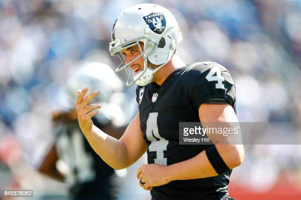 Quarterback Derek Carr of the Oakland Raiders runs back to his bench in the second half at Nissan Stadium on September 10 2017 In Nashville Tennessee