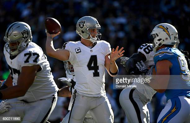 Quarterback Derek Carr of the Oakland Raiders throws from the pocket during his team's game against the San Diego Chargers at Qualcomm Stadium on...