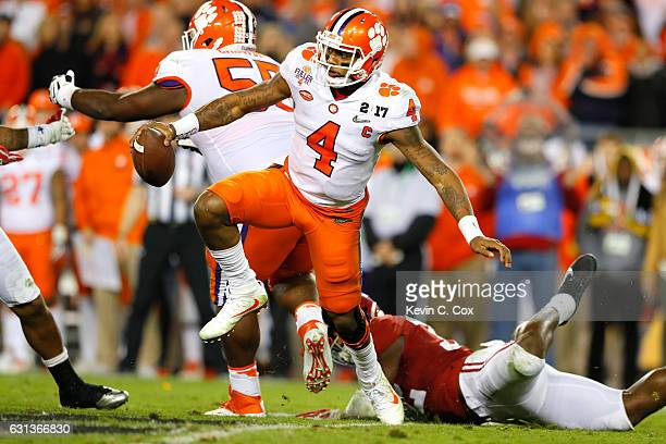 Quarterback Deshaun Watson of the Clemson Tigers avoids pressure during the second half of the 2017 College Football Playoff National Championship...
