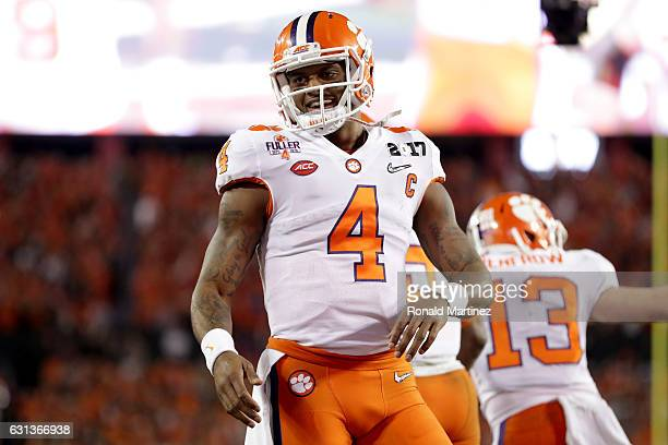 Quarterback Deshaun Watson of the Clemson Tigers celebrates after throwing a 24yard touchdown pass during the third quarter against the Alabama...