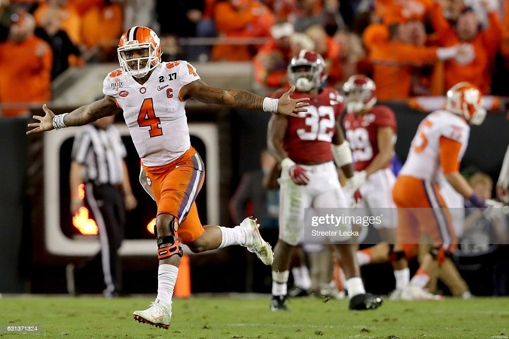 Quarterback Deshaun Watson #4 of the Clemson Tigers celebrates after throwing a 2-yard game-winning touchdown pass during the fourth quarter against the Alabama Crimson Tide to win the 2017 College Football Playoff National Championship Game 35-31 at Raymond James Stadium on January 9, 2017 in Tampa, Florida.