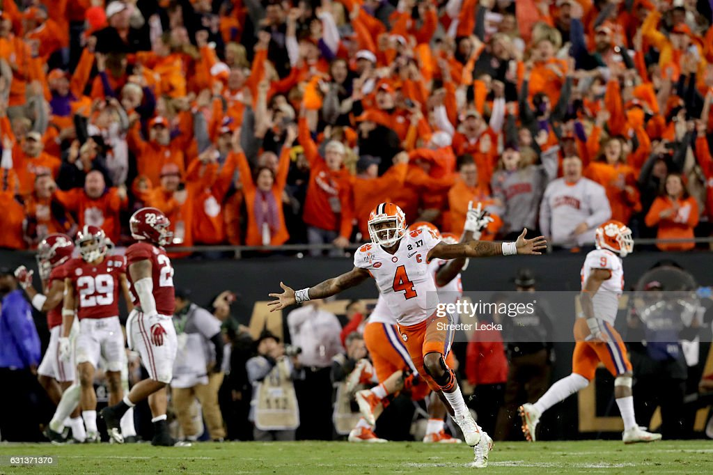 Quarterback Deshaun Watson #4 of the Clemson Tigers celebrates after throwing a 2-yard game-winning touchdown pass during the fourth quarter against the Alabama Crimson Tide to win the 2017 College Football Playoff National Championship Game at Raymond James Stadium on January 9, 2017 in Tampa, Florida.