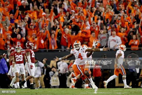 Quarterback Deshaun Watson of the Clemson Tigers celebrates after throwing a 2yard gamewinning touchdown pass during the fourth quarter against the...