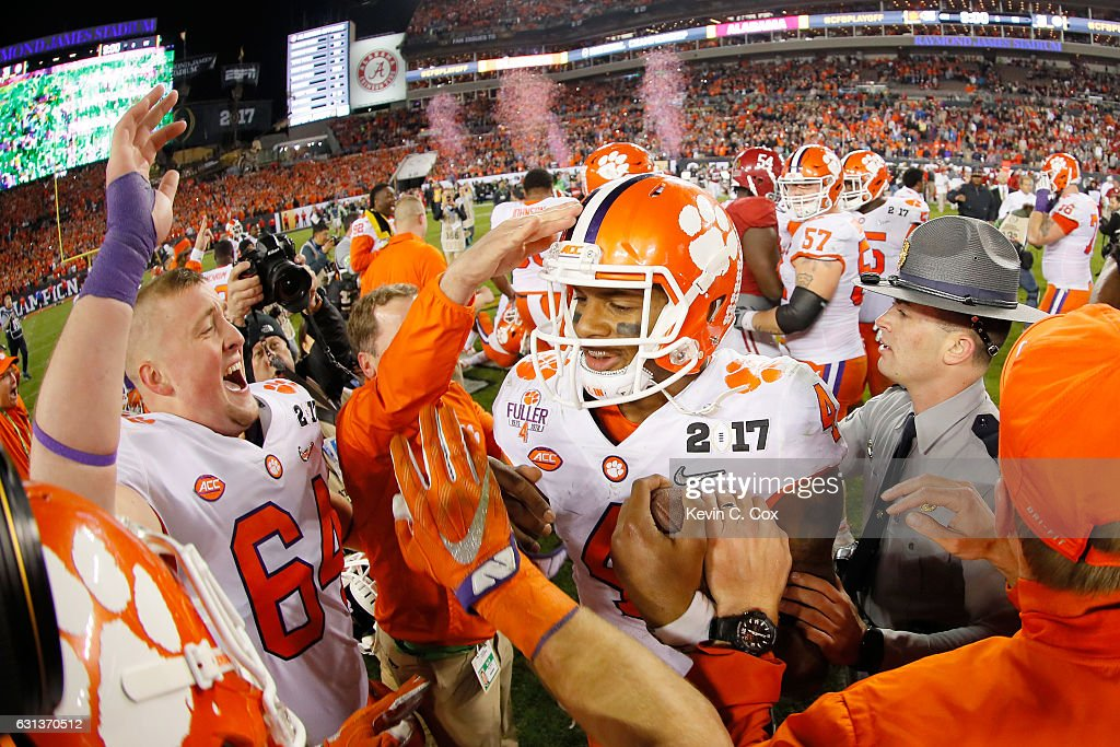 Quarterback Deshaun Watson #4 of the Clemson Tigers celebrates with teammates after defeating the Alabama Crimson Tide 35-31 to win the 2017 College Football Playoff National Championship Game at Raymond James Stadium on January 9, 2017 in Tampa, Florida.