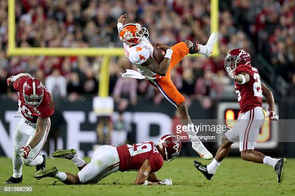 Quarterback Deshaun Watson of the Clemson Tigers is tackled short of the first down by linebacker Reuben Foster and defensive back Minkah Fitzpatrick...