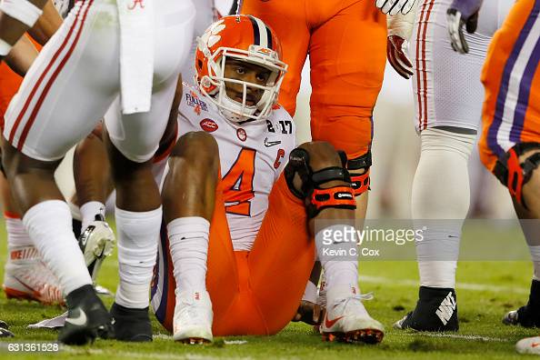 Quarterback Deshaun Watson of the Clemson Tigers reacts on the ground during the first half against the Alabama Crimson Tide in the 2017 College...