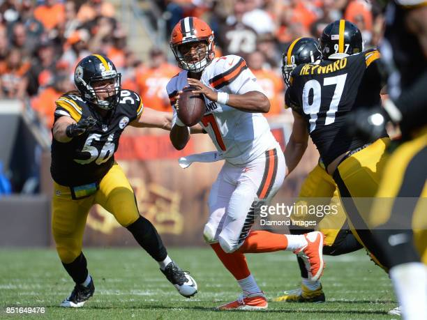 Quarterback DeShone Kizer of the Cleveland Browns moves to avoid pressure from linebackers TJ Watt Anthony Chickillo and defensive end Cameron...