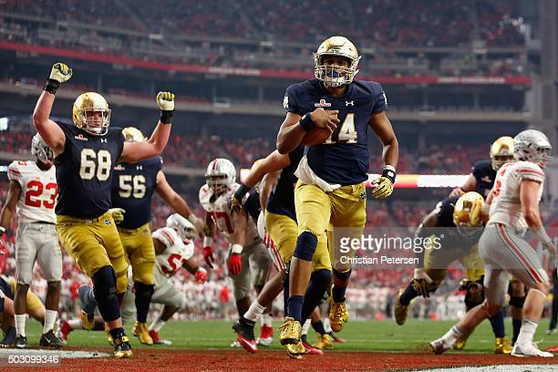 Quarterback DeShone Kizer of the Notre Dame Fighting Irish scores on a one yard rushing touchdown against the Ohio State Buckeyes during the second...