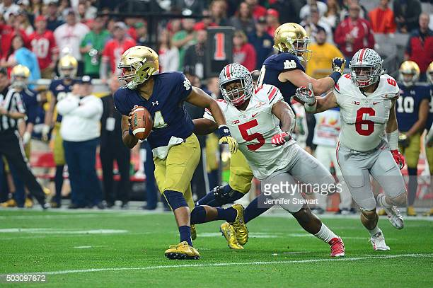 Quarterback DeShone Kizer of the Notre Dame Fighting Irish slips past linebacker Raekwon McMillan of the Ohio State Buckeyes during the first quarter...