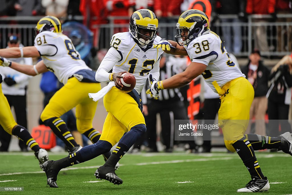 Quarterback Devin Gardner #12 of the Michigan Wolverines controls the ball against the Ohio State Buckeyes at Ohio Stadium on November 24, 2012 in Columbus, Ohio.