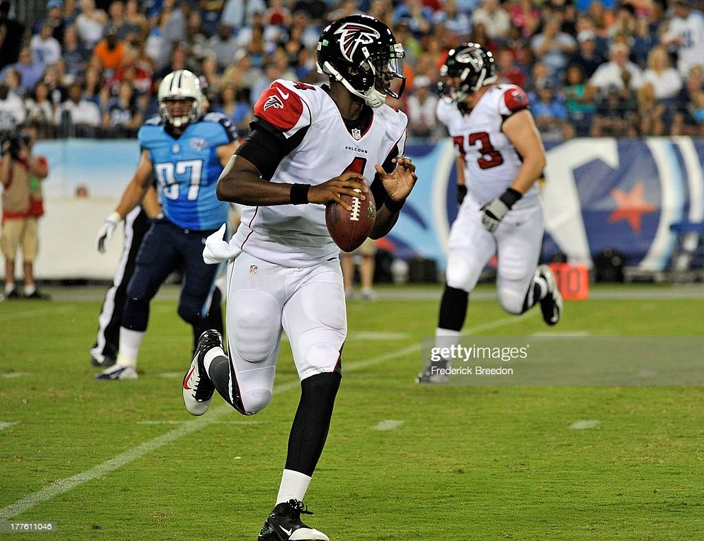 Quarterback <a gi-track='captionPersonalityLinkClicked' href=/galleries/search?phrase=Dominique+Davis&family=editorial&specificpeople=5534461 ng-click='$event.stopPropagation()'>Dominique Davis</a> #4 of the Atlanta Falcons rolls out against the Tennessee Titans at LP Field on August 24, 2013 in Nashville, Tennessee.