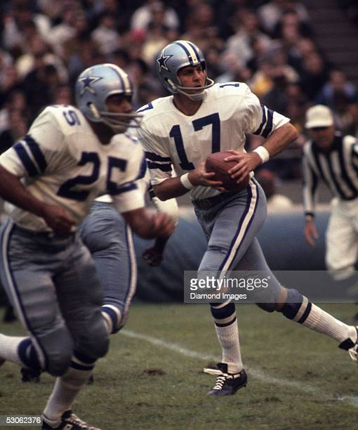Quarterback Don Meredith of the Dallas Cowboys drops back to throw a pass during a game in October 1968 Runningback Les Shy moves into position to...