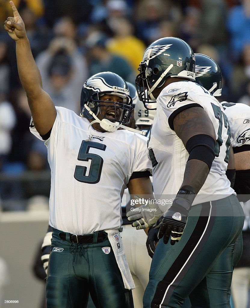 Quarterback Donovan McNabb #5 of the Philadelphia Eagles celebrates during the game against the Carolina Panthers on November 30, 2003 at Ericsson Stadium in Charlotte, North Carolina. The Eagles defeated the Panthers 25-15.