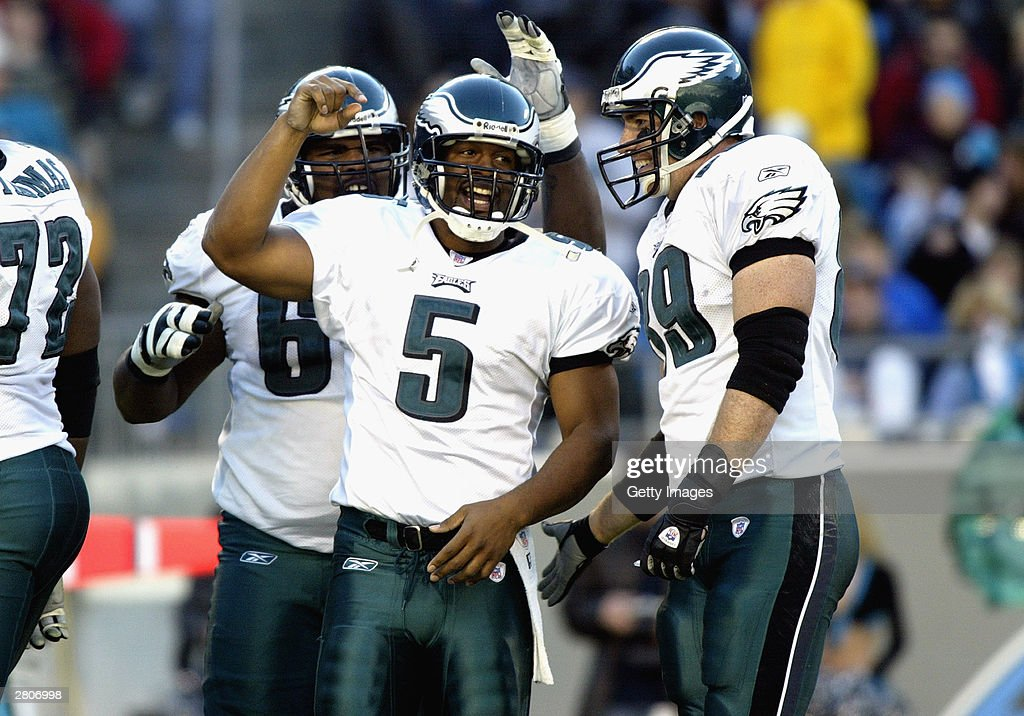Quarterback Donovan McNabb #5 of the Philadelphia Eagles celebrates with teammates during the game against the Carolina Panthers on November 30, 2003 at Ericsson Stadium in Charlotte, North Carolina. The Eagles defeated the Panthers 25-15.