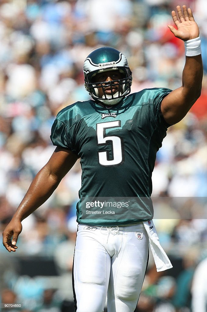 Quarterback Donovan McNabb #5 of the Philadelphia Eagles signals to his team during the NFL season opener against the Carolina Panthers at Bank of America Stadium on September 13, 2009 in Charlotte, North Carolina.