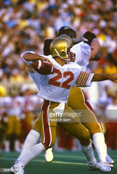 Quarterback Doug Flutie of Boston College University drops back to pass during an NCAA College football game circa 1983 Flutie played at Boston...