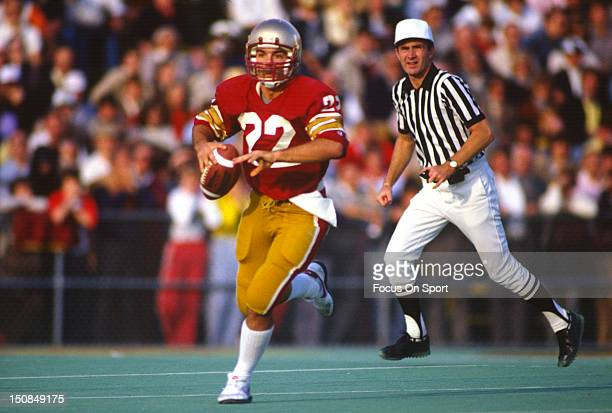 Quarterback Doug Flutie of Boston College University rolls out to pass against Penn State University during an NCAA College football game October 29...