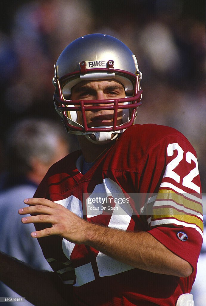 Quarterback <a gi-track='captionPersonalityLinkClicked' href=/galleries/search?phrase=Doug+Flutie&family=editorial&specificpeople=184503 ng-click='$event.stopPropagation()'>Doug Flutie</a> #22 of Boston College University warms up against Penn State University before an NCAA College football game October 29, 1983 at Alumni Stadium in Boston, Massachusetts. Flutie played at Boston College from 1981-84.