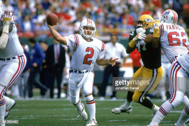 Quarterback Doug Flutie of the New England Patriots prepares to pass the ball during the game against the Green Bay Packers in 1988 at Lambeau Field...