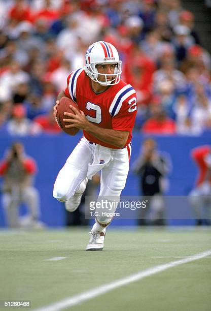 Quarterback Doug Flutie of the New England Patriots scrambles for yards during a game against the Houston Oilers at Foxboro Stadium on October 8 1989...