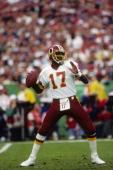 Quarterback Doug Williams of the Washington Redskins drops back to pass during Super Bowl XXII against the Denver Broncos at Jack Murphy Stadium on...