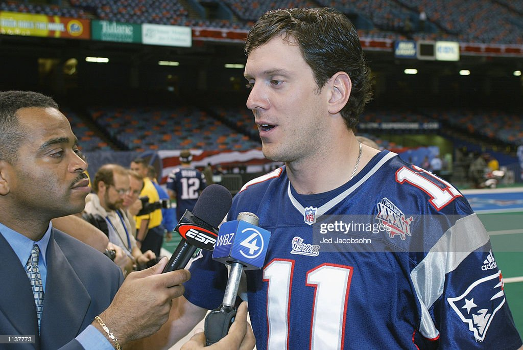 Quarterback <a gi-track='captionPersonalityLinkClicked' href=/galleries/search?phrase=Drew+Bledsoe&family=editorial&specificpeople=183356 ng-click='$event.stopPropagation()'>Drew Bledsoe</a> #11 of the New England Patriots speaks with ESPN's <a gi-track='captionPersonalityLinkClicked' href=/galleries/search?phrase=Stuart+Scott+-+Sportscaster&family=editorial&specificpeople=553713 ng-click='$event.stopPropagation()'>Stuart Scott</a> during Super Bowl XXXVI Media Day on January 29, 2002 at the Super Dome in New Orleans, Louisiana.