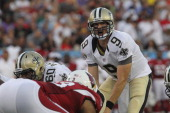 Quarterback Drew Brees of the New Orleans Saints calls a play when the New Orleans Saints play the Arizona Cardinals in the Hall of Fame Game at...