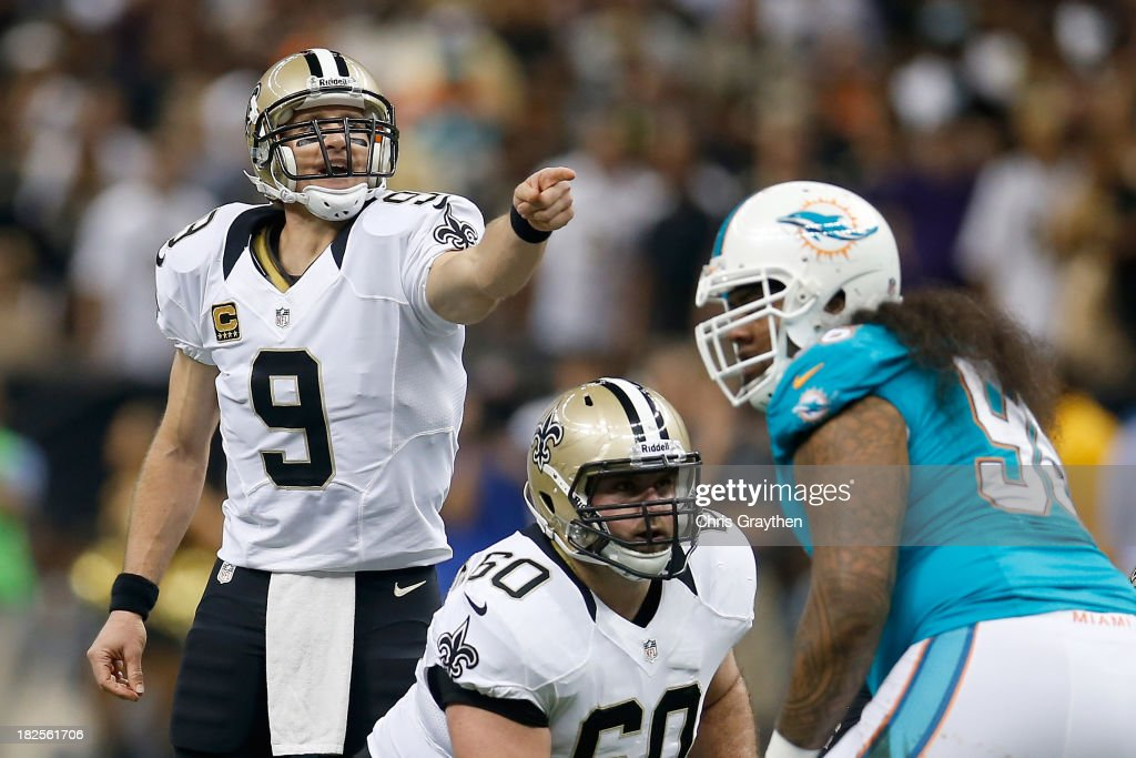 Quarterback <a gi-track='captionPersonalityLinkClicked' href=/galleries/search?phrase=Drew+Brees&family=editorial&specificpeople=202562 ng-click='$event.stopPropagation()'>Drew Brees</a> #9 of the New Orleans Saints calls out from under center in the first quarter against the Miami Dolphins at the Mercedes-Benz Superdome on September 30, 2013 in New Orleans, Louisiana.
