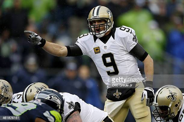 Quarterback Drew Brees of the New Orleans Saints calls out from under center in the first half against the Seattle Seahawks during the NFC Divisional...
