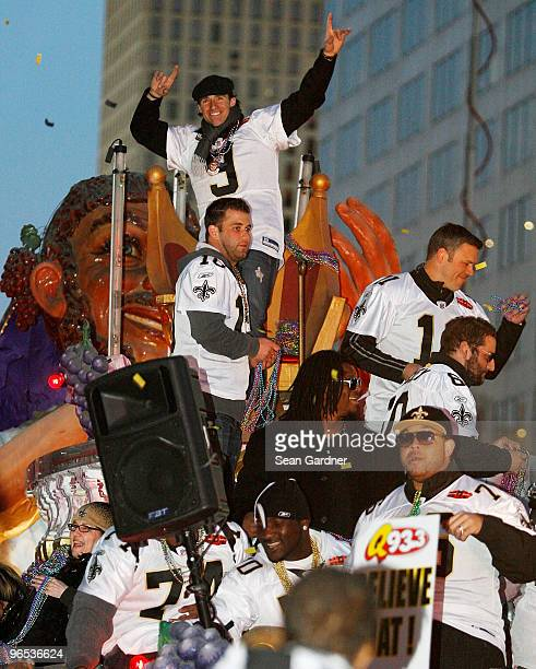Quarterback Drew Brees of the New Orleans Saints celebrates as his team parades though the city after winning Super Bowl XLIV on February 9 2010 in...