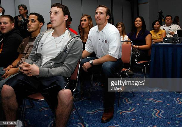 Quarterback Drew Brees of the New Orleans Saints participates with local high school students at the VISA 'Financial Football' Super Bowl at the...