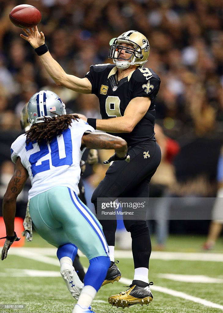 Quarterback <a gi-track='captionPersonalityLinkClicked' href=/galleries/search?phrase=Drew+Brees&family=editorial&specificpeople=202562 ng-click='$event.stopPropagation()'>Drew Brees</a> #9 of the New Orleans Saints passes as cornerback <a gi-track='captionPersonalityLinkClicked' href=/galleries/search?phrase=B.W.+Webb&family=editorial&specificpeople=7308996 ng-click='$event.stopPropagation()'>B.W. Webb</a> #20 of the Dallas Cowboys defends during a game at the Mercedes-Benz Superdome on November 10, 2013 in New Orleans, Louisiana.
