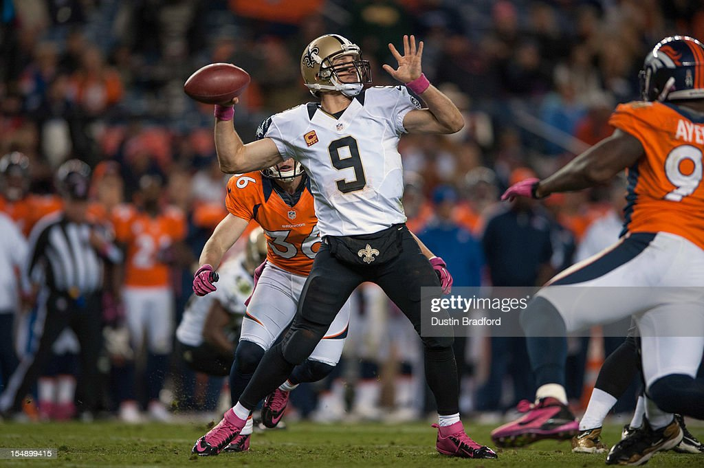 Quarterback <a gi-track='captionPersonalityLinkClicked' href=/galleries/search?phrase=Drew+Brees&family=editorial&specificpeople=202562 ng-click='$event.stopPropagation()'>Drew Brees</a> #9 of the New Orleans Saints passes as free safety <a gi-track='captionPersonalityLinkClicked' href=/galleries/search?phrase=Jim+Leonhard&family=editorial&specificpeople=240112 ng-click='$event.stopPropagation()'>Jim Leonhard</a> #36 of the Denver Broncos pressures during a game at Sports Authority Field Field at Mile High on October 28, 2012 in Denver, Colorado.