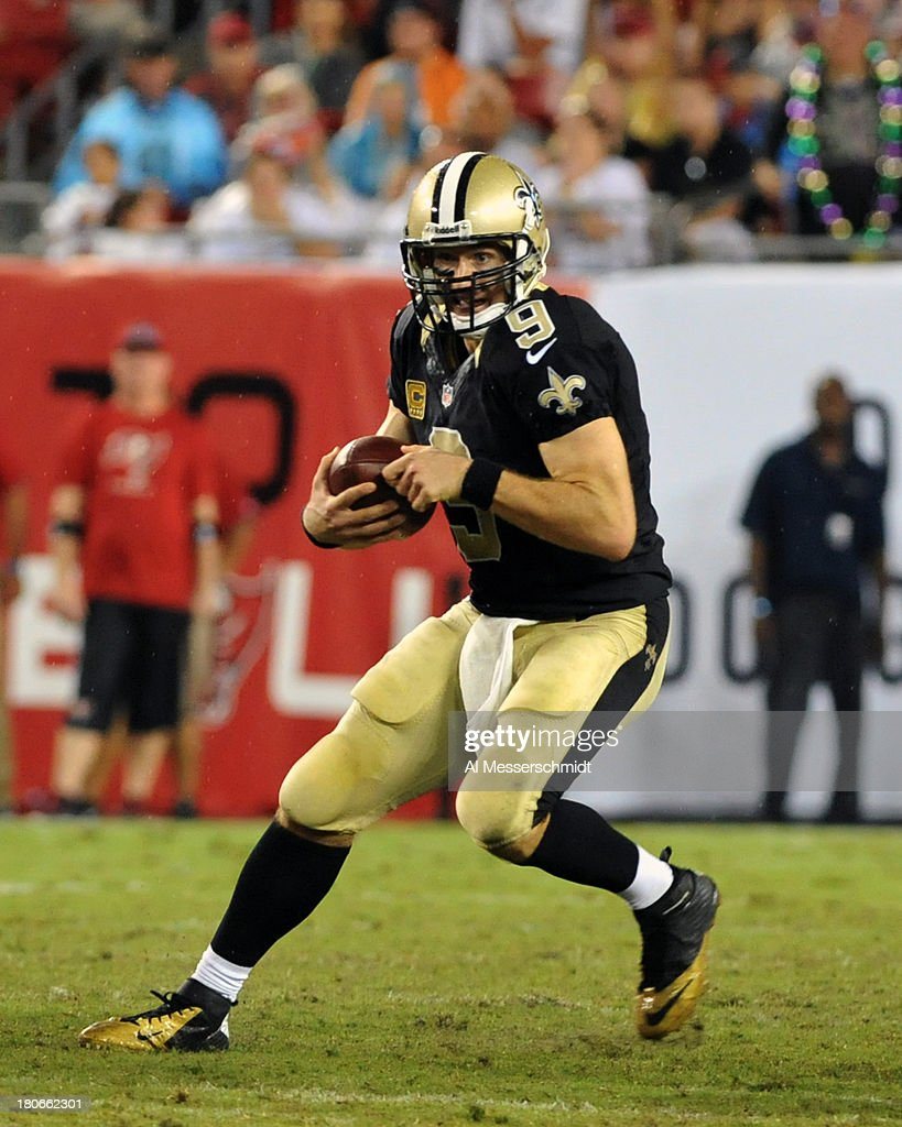 Quarterback Drew Brees #9 of the New Orleans Saints protects the football in the 4th quarter against the Tampa Bay Buccaneers September 15, 2013 at Raymond James Stadium in Tampa, Florida. The Saints won 16 - 14.