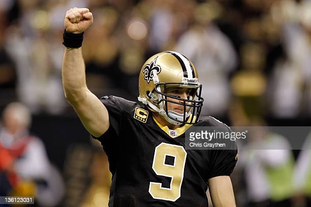 Quarterback Drew Brees of the New Orleans Saints reacts after throwing a nineyard touchdown pass to running back Darren Sproles and breaks the...