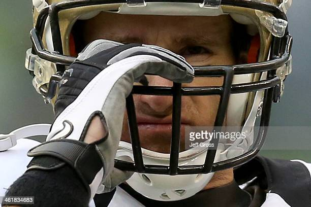 Quarterback Drew Brees of the New Orleans Saints reacts in the second quarter while taking on the Seattle Seahawks during the NFC Divisional Playoff...