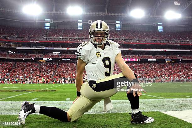 Quarterback Drew Brees of the New Orleans Saints stretches before the start of the NFL game against the Arizona Cardinals at the University of...