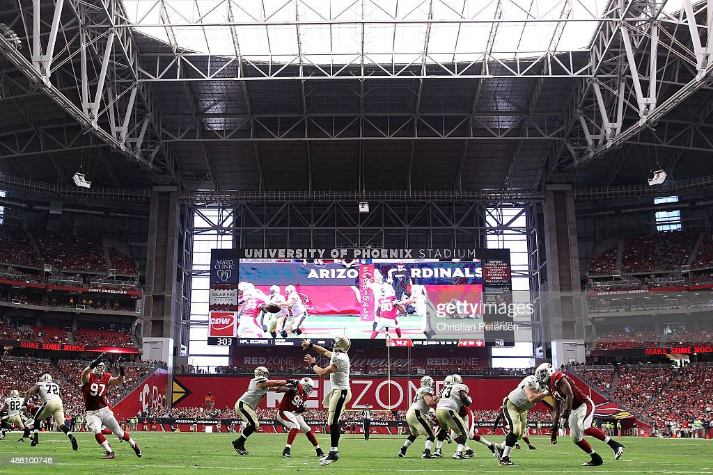 Quarterback Drew Brees of the New Orleans Saints throws a pass during the second quarter of the NFL game at the University of Phoenix Stadium on...