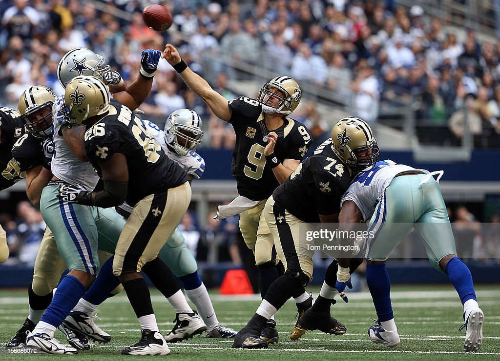 Quarterback <a gi-track='captionPersonalityLinkClicked' href=/galleries/search?phrase=Drew+Brees&family=editorial&specificpeople=202562 ng-click='$event.stopPropagation()'>Drew Brees</a> #9 of the New Orleans Saints throws to an open receiver against the Dallas Cowboys at Cowboys Stadium on December 23, 2012 in Arlington, Texas. The New Orleans Saints beat the Dallas Cowboys 34-31 in overtime.