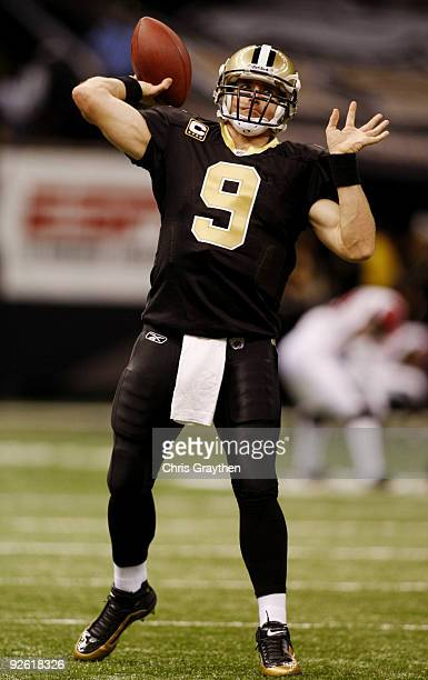 Quarterback Drew Brees of the New Orleans Saints warms up before his team takes on the Atlanta Falcons in the game at the Louisiana Superdome on...