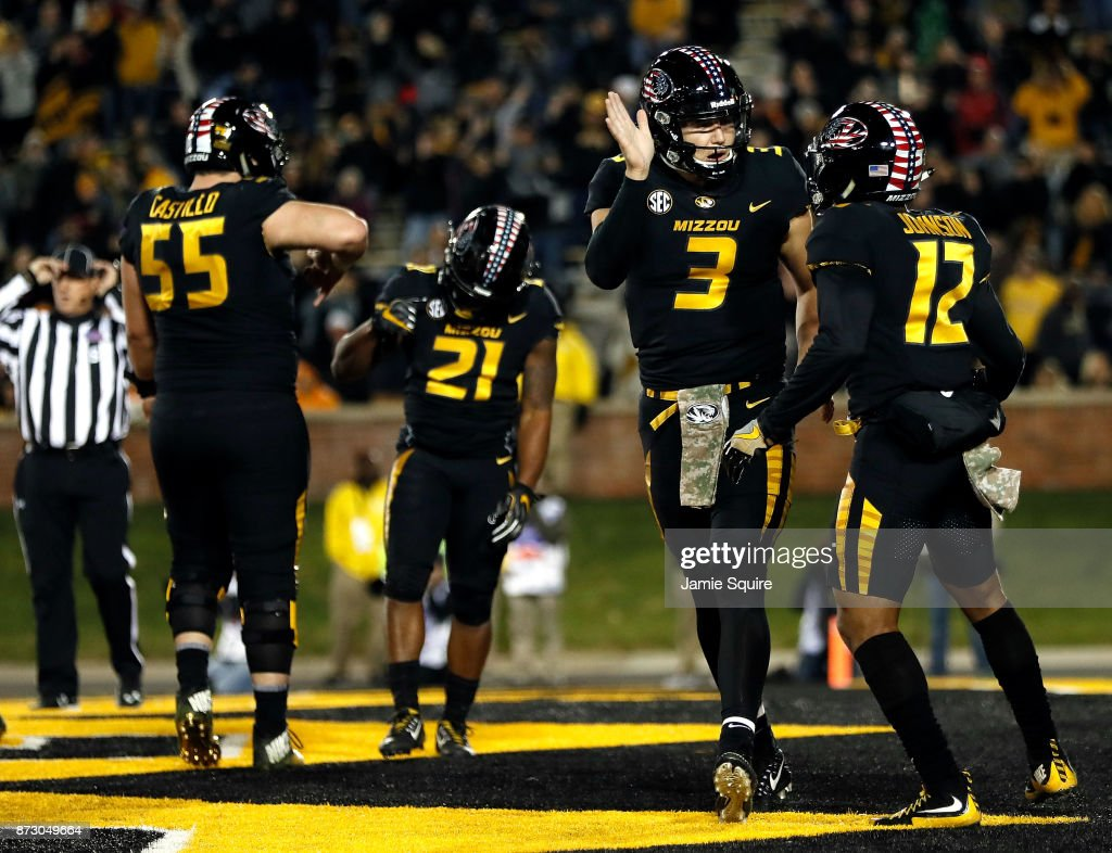 Quarterback Drew Lock #3 of the Missouri Tigers celebrates with teammates after a touchdown during the game against the Tennessee Volunteers at Faurot Field/Memorial Stadium on November 11, 2017 in Columbia, Missouri.