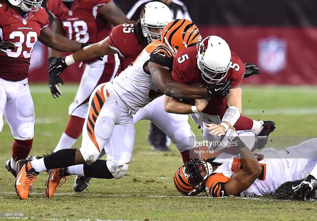 Quarterback Drew Stanton #5 of the Arizona Cardinals is tackled by safety Taylor Mays #26 (R) and linebacker Vincent Rey #57 (L) against the Cincinnati Bengals at University of Phoenix Stadium on August 24, 2014 in Glendale, Arizona.