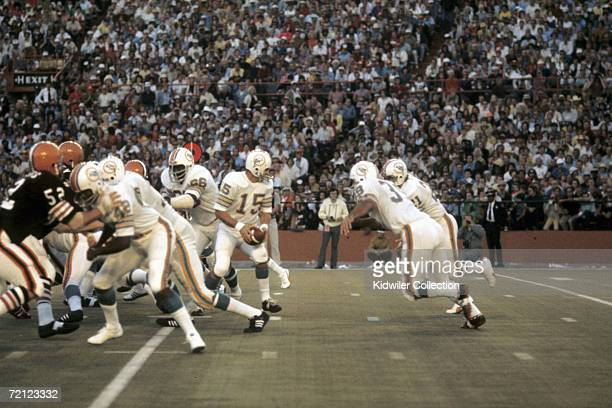 Quarterback Earl Morrall of the Miami Dolphins turns to hand the ball off during a game on December 23 1972 against the San Diego Chargers at the...