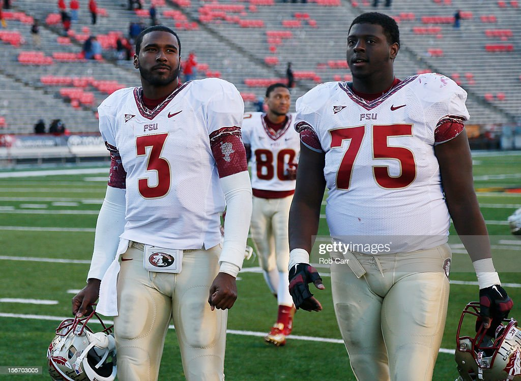 Quarterback EJ Manuel #3 and offensive linesman Cameron Erving #75 of the Florida State Seminoles walk off the field following the Seminoles 41-14 win over the Maryland Terrapins at Byrd Stadium on November 17, 2012 in College Park, Maryland.