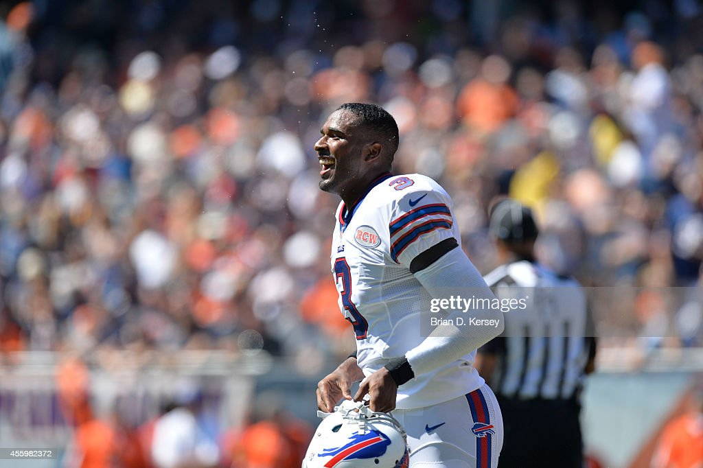 Quarterback EJ Manuel #3 of the Buffalo Bills smiles after his 2-yard touchdown run during the first quarter against the Chicago Bears on September 7, 2014 at Soldier Field in Chicago, Illinois. The Bills defeated the Bears 23-20 in overtime.