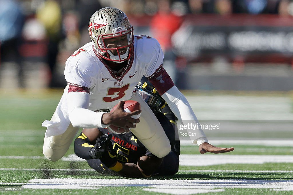 Quarterback EJ Manuel of the Florida State Seminoles is tackled by linebacker Kenneth Tate #6 of the Maryland Terrapins during the first half of their game at Byrd Stadium on November 17, 2012 in College Park, Maryland.