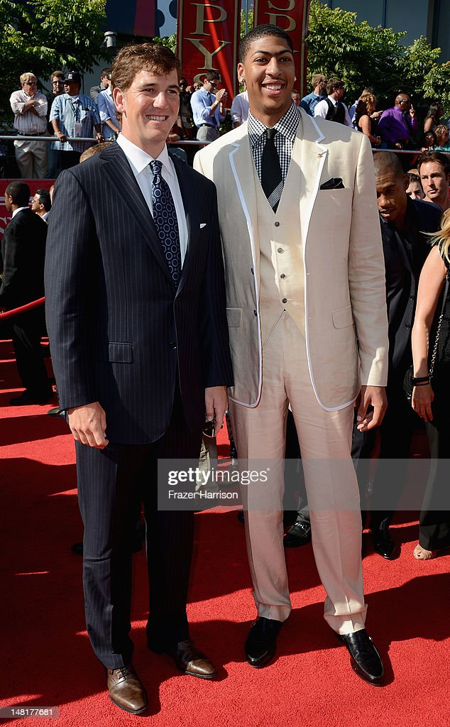 NFL quarterback Eli Manning and NBA player Anthony Davis arrive at the 2012 ESPY Awards at Nokia Theatre L.A. Live on July 11, 2012 in Los Angeles, California.
