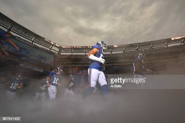 Quarterback Eli Manning of the New York Giants and teammates take the field before playing against the New Orleans Saints at MetLife Stadium on...