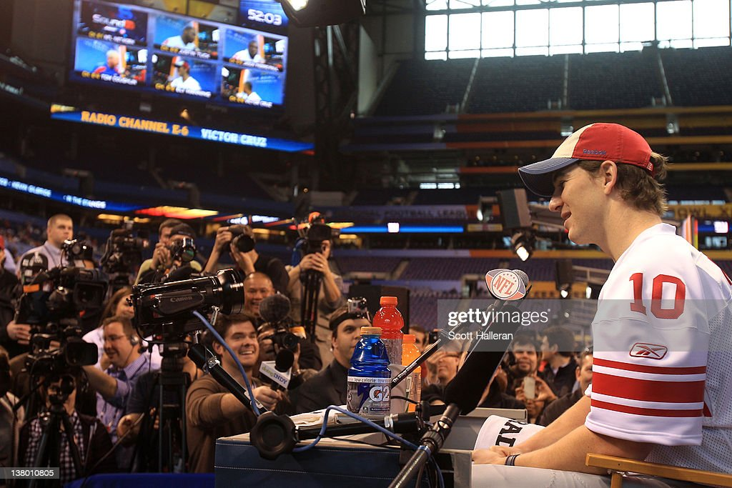 Quarterback <a gi-track='captionPersonalityLinkClicked' href=/galleries/search?phrase=Eli+Manning&family=editorial&specificpeople=202013 ng-click='$event.stopPropagation()'>Eli Manning</a> #10 of the New York Giants answers question from the media during Media Day ahead of Super Bowl XLVI against the New England Patriots at Lucas Oil Stadium on January 31, 2012 in Indianapolis, Indiana.