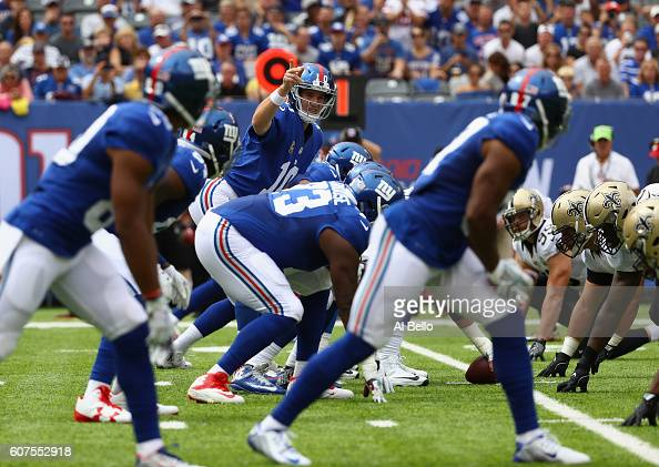 Quarterback Eli Manning of the New York Giants calls a play at the line of scrimmage against the New Orleans Saints during the first quarter at...